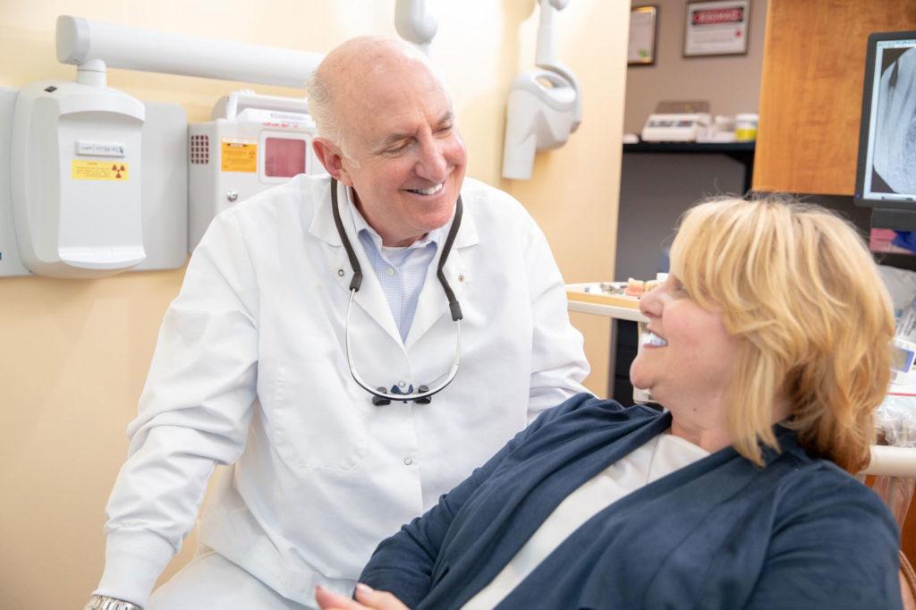 Doctor answering FAQ Select Dental