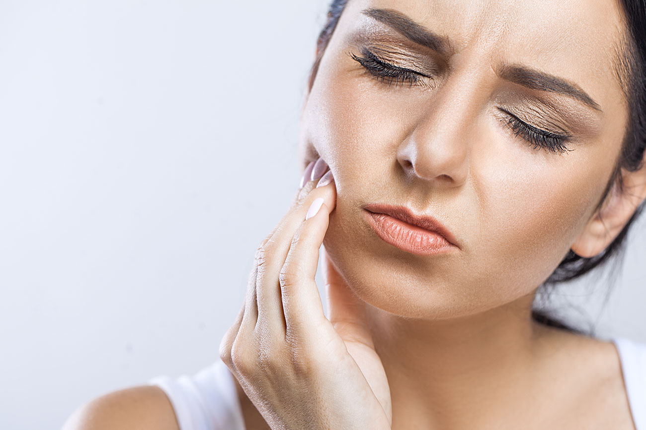woman in need of a root canal Select Dental