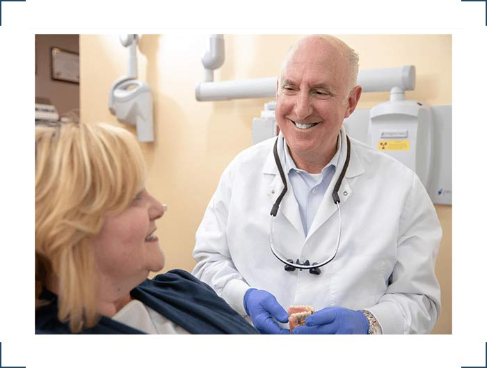 Dr Shoflick talking to patient about dental implants Select Dental
